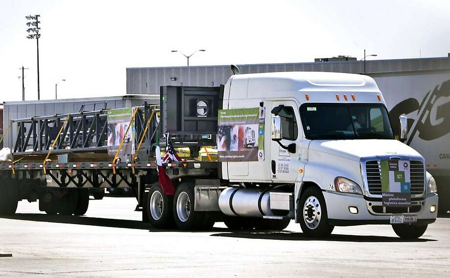 The first commercial truck from Mexico that will travel to Garland, Texas from Apocada, Nuevo Leon, Mexico, enters the U.S. Customs Import Lot for secondary inspection at the World Trade Bridge in Laredo, Texas, Friday, Oct. 21, 2011. For the first time under the North American Free Trade Agreement, a Mexican tractor-trailer has crossed the border into the U.S. on its way into the country's interior. The NAFTA trucking program was stalled for years by concerns that it would put highway safety and American jobs at risk. But the commercial truck hauling a steel drilling structure entered the United States on Friday afternoon, nearly two decades after passage of the agreement, which was supposed to improve cargo transportation between the two countries. (AP Photo/The Laredo Morning Times, Ricardo Santos) Photo: Ricardo Santos, AP