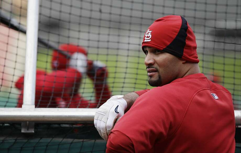 St. Louis Cardinals' Albert Pujols waits to take batting practice before Game 2 of baseball's World Series against the Texas Rangers Thursday, Oct. 20, 2011, in St. Louis. (AP Photo/Matt Slocum)  Ran on: 10-23-2011 Cardinals first baseman Albert Pujols waits to take batting practice before Thursday's Game 2 of the World Series, which might have been one of his final games with St. Louis. Ran on: 10-23-2011 Cardinals first baseman Albert Pujols waits to take batting practice before Thursday's Game 2 of the World Series, which might have been one of his final games with St. Louis. Photo: Matt Slocum, AP