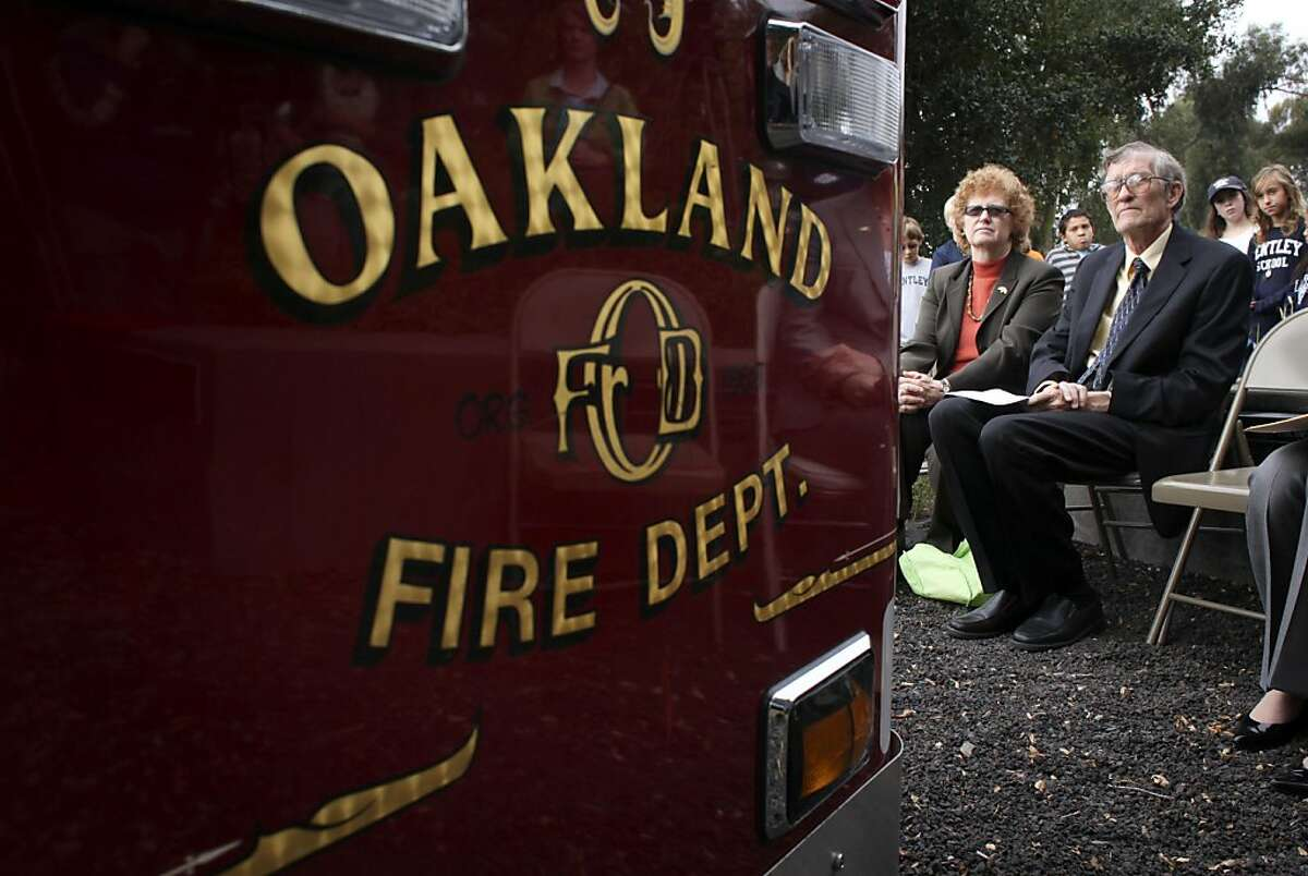 Sue and Gordon Piper, who lost their home in the firestorm listens to Oakland's Mayor Jean Quan address the suvivors to commemorate the 20th anniversary of the 1991 Oakland Firestorm, Thursday October 20, 2011, at the Firestorm Memorial Garden in Oakland, Calif.