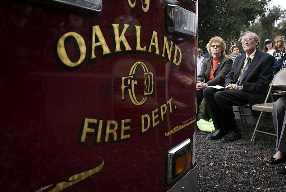 Sue and Gordon Piper, who lost their home in the firestorm listens to Oakland's Mayor Jean Quan address the suvivors to commemorate the 20th anniversary of the 1991 Oakland Firestorm, Thursday October 20, 2011, at the Firestorm Memorial Garden in Oakland, Calif. Photo: Lacy Atkins, The Chronicle