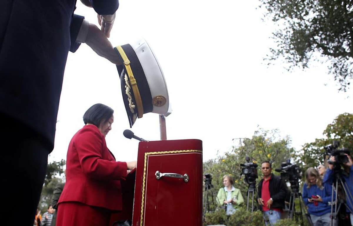 Oakland's Mayor Jean Quan with interim Fire Chief Mark Hoffman, left by her side address the fire suvivors to commemorate the 20th anniversary of the 1991 Oakland Firestorm, Thursday October 20, 2011, at the Firestorm Memorial Garden in Oakland, Calif.