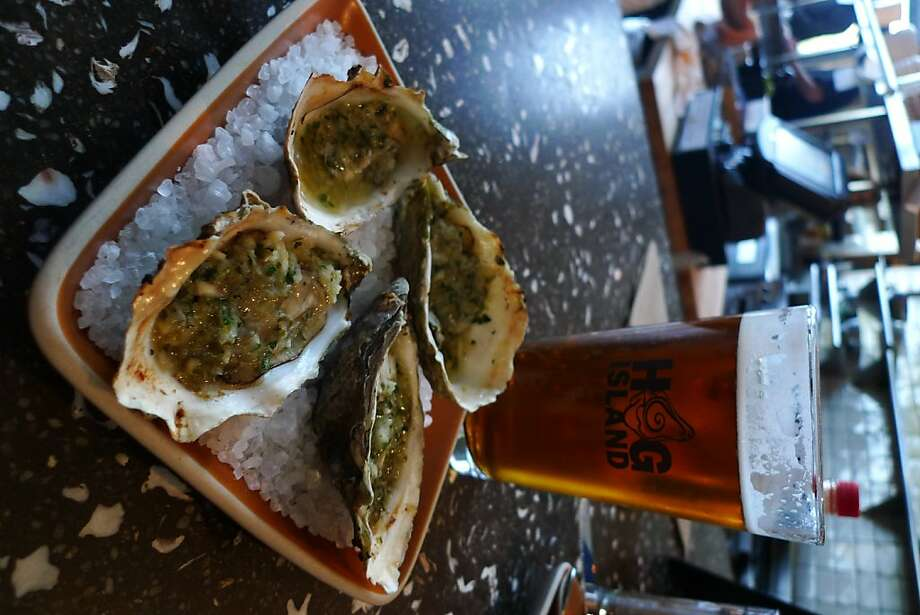 Hog Island Oyster in downtown Napa   Ran on: 12-19-2010 Grilled treats and local brews at Hog Island Oyster Company in the Oxbow Public Market. Photo: Spud Hilton, The Chronicle