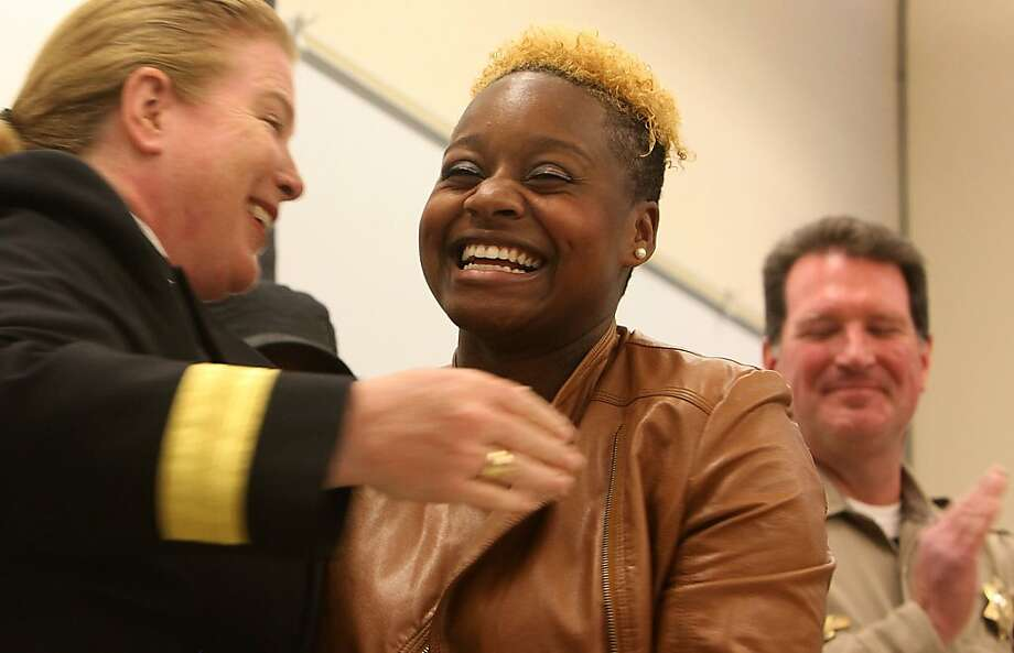 Keenia Williams (left), 22 years old, who rescued Michael Finerty this morning from his burning truck on highway 101 in San Francisco, Calif., gets a hug from fire department chief Joanne Hayes-White (left)  at a press conference on Wednesday, October 19, 2011. Photo: Liz Hafalia, The Chronicle