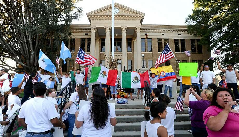 Marchers gather on the steps of the Limestone County Courthouse to protest Alabama's immigration law, Sunday, Oct. 16, 2011, in Athens, Ala. Approximately 300 people marched protesting the tough immigration law. (AP Photo/The Decatur Daily, Gary Cosby Jr.) Photo: Gary Cosby Jr, AP
