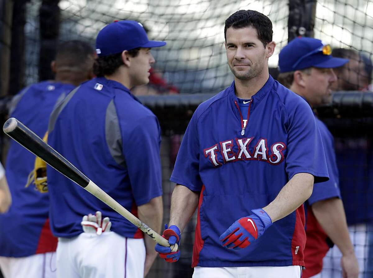 Texas Rangers' Michael Young takes batting practice Friday, Oct. 21, 2011, in Arlington, Texas. The Rangers are scheduled to play the St. Louis Cardinals in Game 3 of baseball's World Series on Saturday. (AP Photo/Tony Gutierrez)