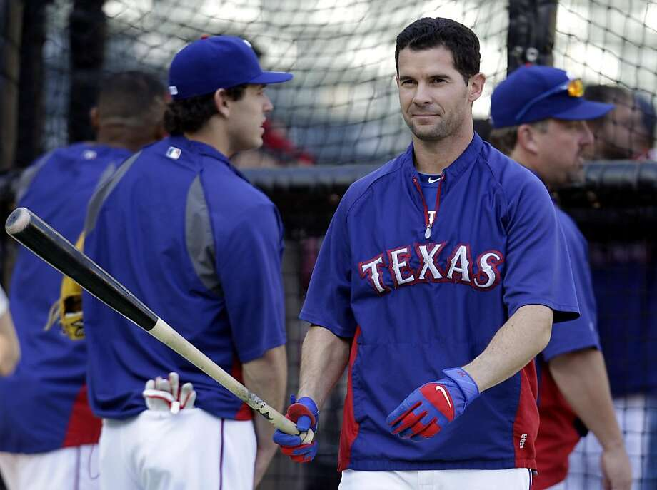 Texas Rangers' Michael Young takes batting practice Friday, Oct. 21, 2011, in Arlington, Texas. The Rangers are scheduled to play the St. Louis Cardinals in Game 3 of baseball's World Series on Saturday. (AP Photo/Tony Gutierrez) Photo: Tony Gutierrez, AP