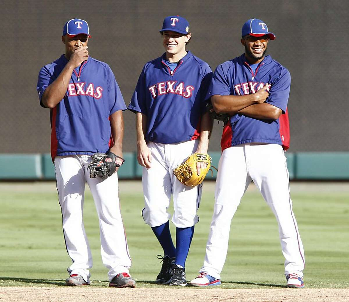 From left, Texas Rangers' Adrian Beltre, Ian Kinsler and Elvis Andrus during workouts at the Rangers Ballpark in Arlington on Friday October 21, 2011, in Arlington, Texas. The Rangers play host to the St. Louis Cardinals in Game 3 of the World Series on Saturday with the series tied, 1-1. (Richard W. Rodriguez/Fort Worth Star-Telegram/MCT)