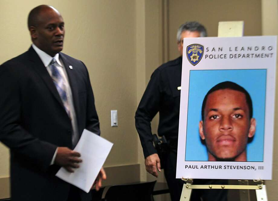 San Leandro Police Sgt Ted Henderson left released a mug shot of Paul Arthur Stevenson 111 during a press conference October 20, 2011 in San Leandro California. Stevenson is being charged in the shooting deaths of three people outside a tattoo party in San Leandro last month. Photo: Lance Iversen, The Chronicle