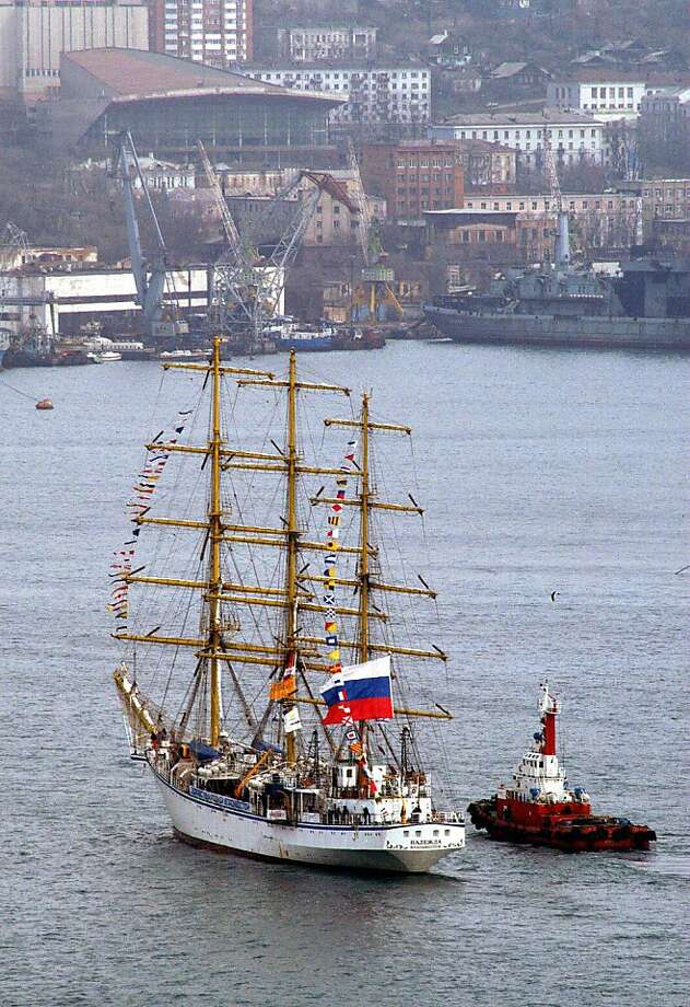 VALDIVOSTOK, RUSSIAN FEDERATION:  The Russian Nadezhda sailing ship enters the harbour of Vladivostok, returning from a 14-month round-the-world voyage 28 March 2004, with 187 crew members on board. After it left Vladivostok last year, Nadezhda sailed around Asia into the Indian Ocean, entered the Mediterranean through the Suez Canal, rounded Europe's western shores and ended up in Russia's second city of Saint Petersburg on the Gulf of Finland in May 2003, in time for the city's 300th anniversary celebrations. In Saint Petersburg it changed its student crew and sailed down through the Atlantic Ocean, rounded South America's tip at Cape Horn and headed north through the Pacific back toward Vladivostok.  AFP PHOTO  (Photo credit should read -/AFP/Getty Images) Photo: -, AFP/Getty Images