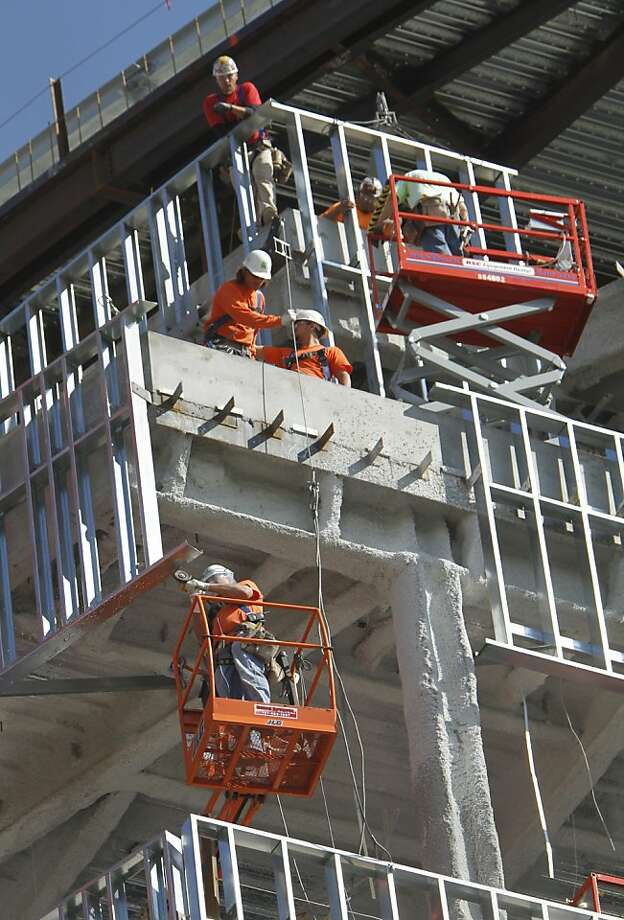 Workers are seen at the construction of a new building in Sacramento, Calif., Friday, Oct. 21, 2011. The state Employment Development Department reported Friday that the unemployment rate decreased slightly as the state added 11,800 nonfarm jobs, led by construction, professional and business services, and leisure and hospitality.(AP Photo/Rich Pedroncelli) Photo: Rich Pedroncelli, AP