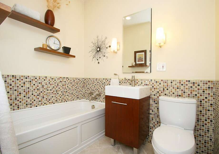 Mosaic tiling brings personality and color to the bathroom. Photo: Clay Seibert