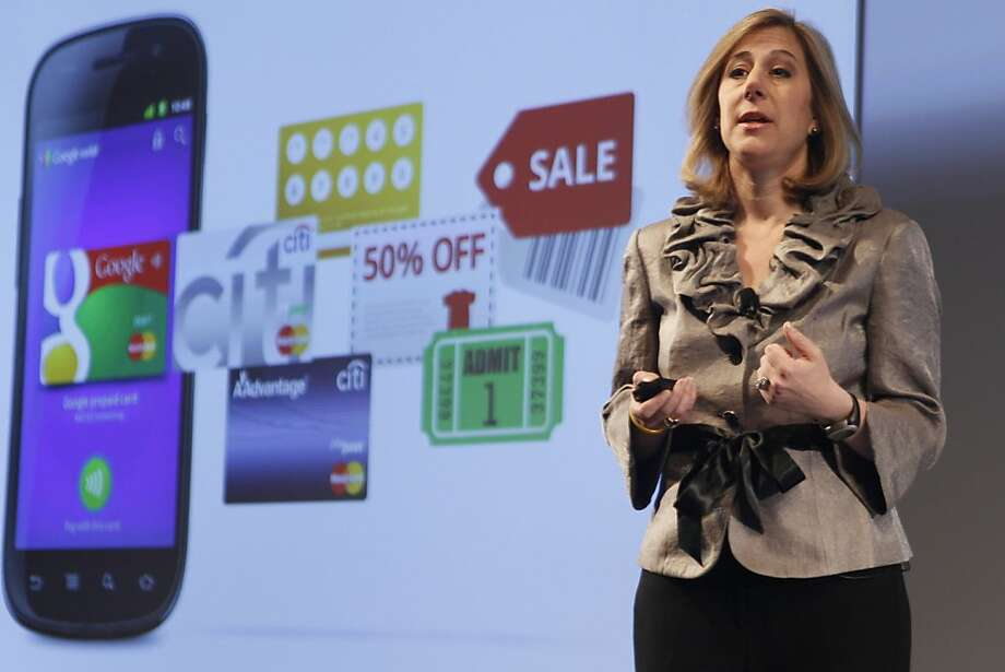 """Google Vice President of Commerce Stephanie Tilenius speaks during a news conference, Thursday, May 26, 2011, in New York.  Google wants the smartphone to be the wallet of the future, a container for digital credit cards, coupons, receipts and loyalty cards that can be """"tapped"""" to terminals in stores.  (AP Photo/Mary Altaffer)  Ran on: 05-27-2011 Google Vice President Stephanie Tilenius says Google Wallet will begin a new generation of point-of-sale systems. Photo: Mary Altaffer, AP"""