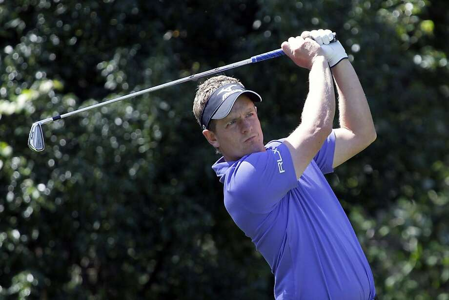 Luke Donald, of England, hits a shot from the seventh tee during the first round of the Children's Miracle Network Hospitals Classic PGA golf tournament  Thursday, Oct. 20, 2011, in Lake Buena Vista, Fla. (AP Photo/John Raoux) Photo: John Raoux, AP
