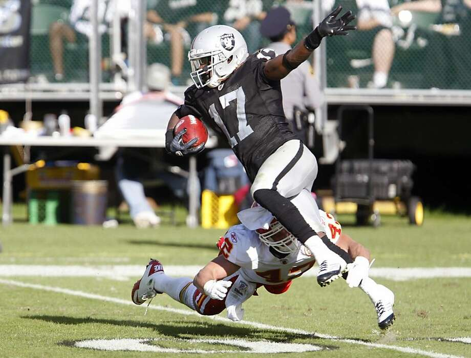 Oakland Raiders Denarius Moore gets past Kansas City Chiefs Sabby Piscitelli for yardage on Sunday Oct. 23, 2011 in Oakland Calif. Photo: Tim Maloney, The Chronicle