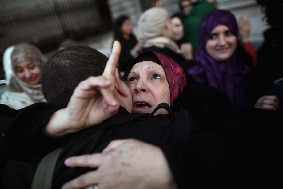 LONDON, ENGLAND - OCTOBER 20:  A woman gestures during celebrations outside the Libyan embassy in Knightsbridge on October 20, 2011 in London, England. News emerged today that the former Libyan leader Col Muammar Gaddafi was killed after an assault on his home town of Sirte in Libya.  (Photo by Dan Kitwood/Getty Images) *** BESTPIX *** Photo: Dan Kitwood, Getty Images