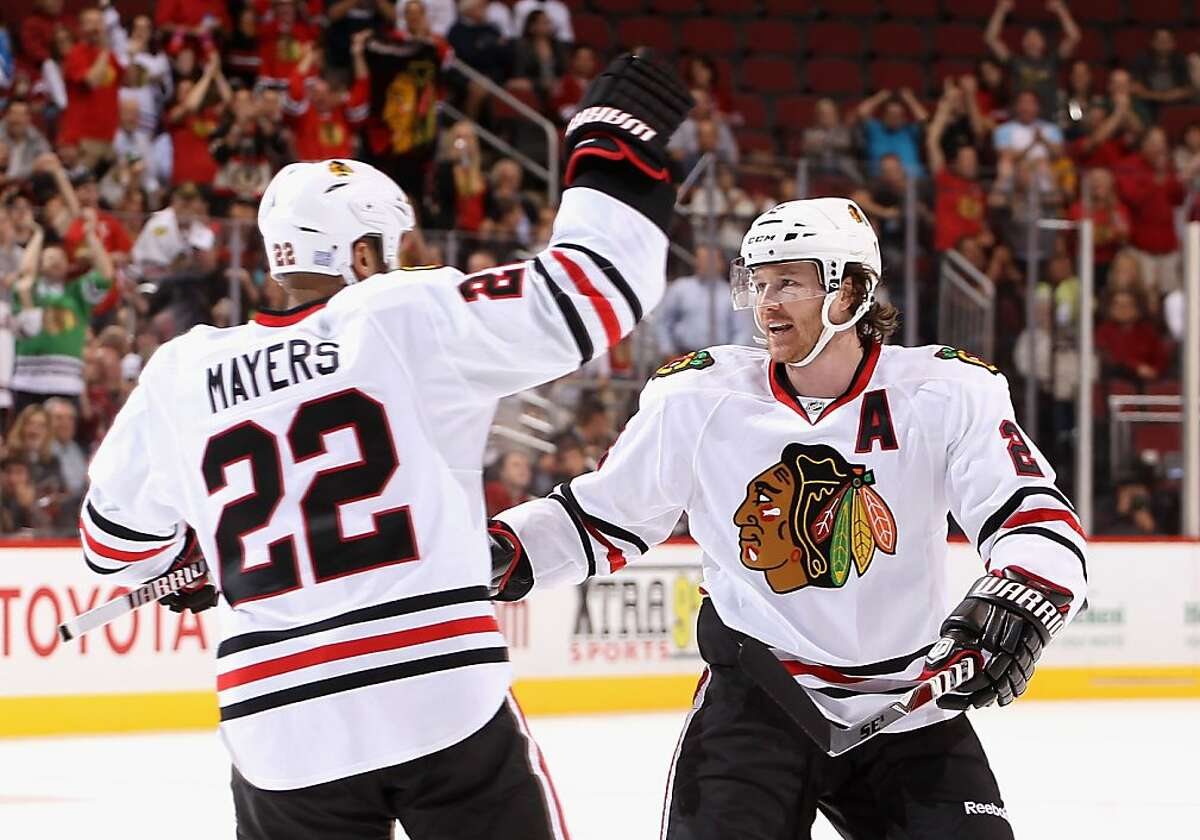 GLENDALE, AZ - OCTOBER 18: Duncan Keith #2 and Jamal Mayers #22 of the Chicago Blackhawks celebrate after Mayers scored a second period goal against the Phoenix Coyotes during the NHL game at Jobing.com Arena on October 18, 2011 in Glendale, Arizona. (Photo by Christian Petersen/Getty Images)