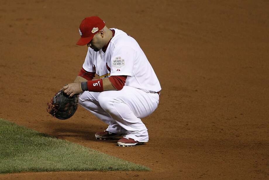 St. Louis Cardinals' Albert Pujols pauses during a pitching change during the ninth inning of Game 2 of baseball's World Series against the Texas Rangers Thursday, Oct. 20, 2011, in St. Louis. (AP Photo/Eric Gay) Photo: Eric Gay, AP