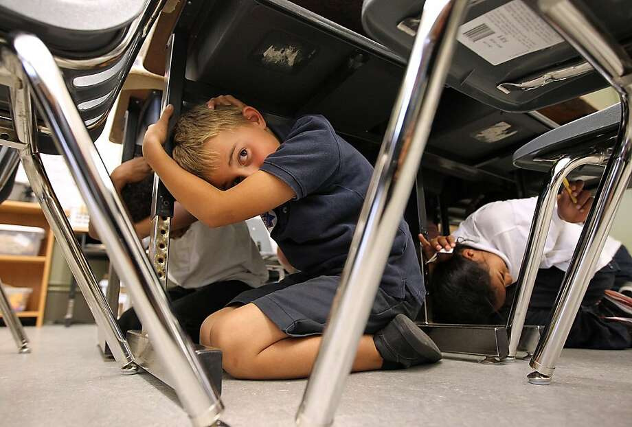 "SAN FRANCISCO, CA - OCTOBER 20:  Third grade students at William L. Cobb Elementary School take cover under desks as they participate in the ""Great California ShakeOut"" earthquake drill on October 20, 2011 in San Francisco, California.  An estimated 8 million Californians will take place in the fourth annual Great California ShakeOut earthquake drill which will help educate residents prepare for a major earthquake.  (Photo by Justin Sullivan/Getty Images) *** BESTPIX *** Photo: Justin Sullivan, Getty Images"