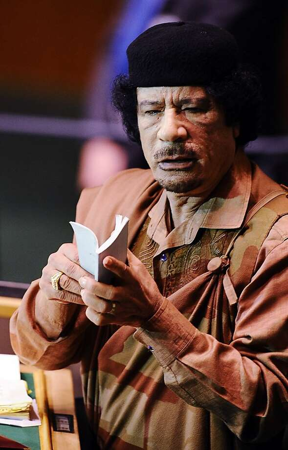NEW YORK - FILE:  Libyan leader Moammar Gadhafi addresses at the 64th General Assembly at United Nations Headquarters on September 23, 2009 in New York City. According to reports October 20, 2011, the former leader of Libya Muammar Gaddafi was killed while fleeing Libyan fighters who had overrun his hometown of Sirte.  (Photo by Jeff Zelevansky/Getty Images) Photo: Jeff Zelevansky, Getty Images