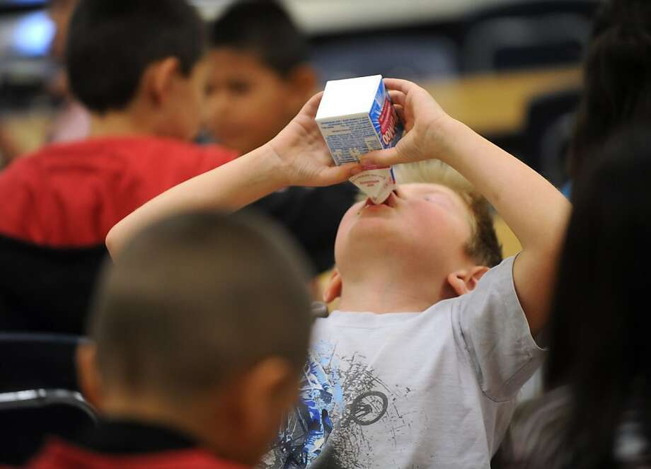 Zain Hargrove, a 2nd-grader at Ortiz Elementary School, drinks his milk during lunch Thursday, Oct. 20, 2011, in Abilene, Texas. Recently, the Texas Department of Agriculture and United States Department of Agriculture launched a statewide campaign to end childhood hunger in Texas by increasing the number of nutritious meals offered at schools. (AP Photo/Abilene Reporter-News, Nellie Doneva) MANDATORY CREDIT Photo: Nellie Doneva, AP