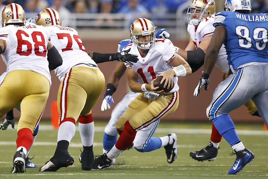 San Francisco 49ers quarterback Alex Smith (11) scrambles during an NFL football game against the Detroit Lions in Detroit, Sunday, Oct. 16, 2011. (AP Photo/Rick Osentoski) Photo: Rick Osentoski, AP