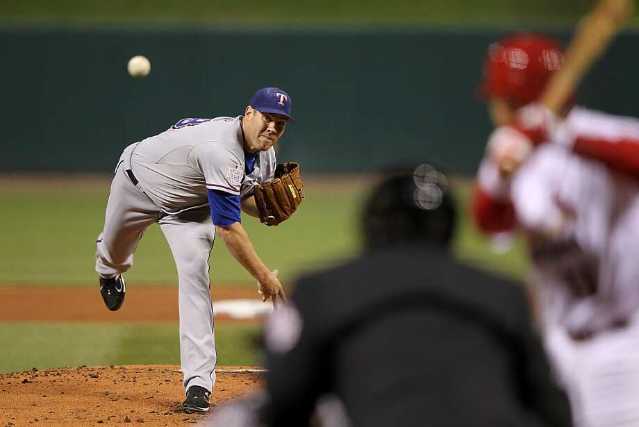 ST LOUIS, MO - OCTOBER 20:  Colby Lewis #48 of the Texas Rangers pitches in the first inning during Game Two of the MLB World Series against the St. Louis Cardinals at Busch Stadium on October 20, 2011 in St Louis, Missouri.  (Photo by Jamie Squire/Getty Images) Photo: Jamie Squire, Getty Images