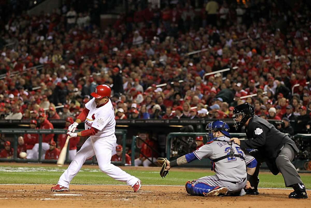 ST LOUIS, MO - OCTOBER 19: Rafael Furcal #15 of the St. Louis Cardinals hits a double in the third inning for the first hit of the game during Game Two of the MLB World Series against the Texas Rangers at Busch Stadium on October 20, 2011 in St Louis, Missouri. (Photo by Jamie Squire/Getty Images)