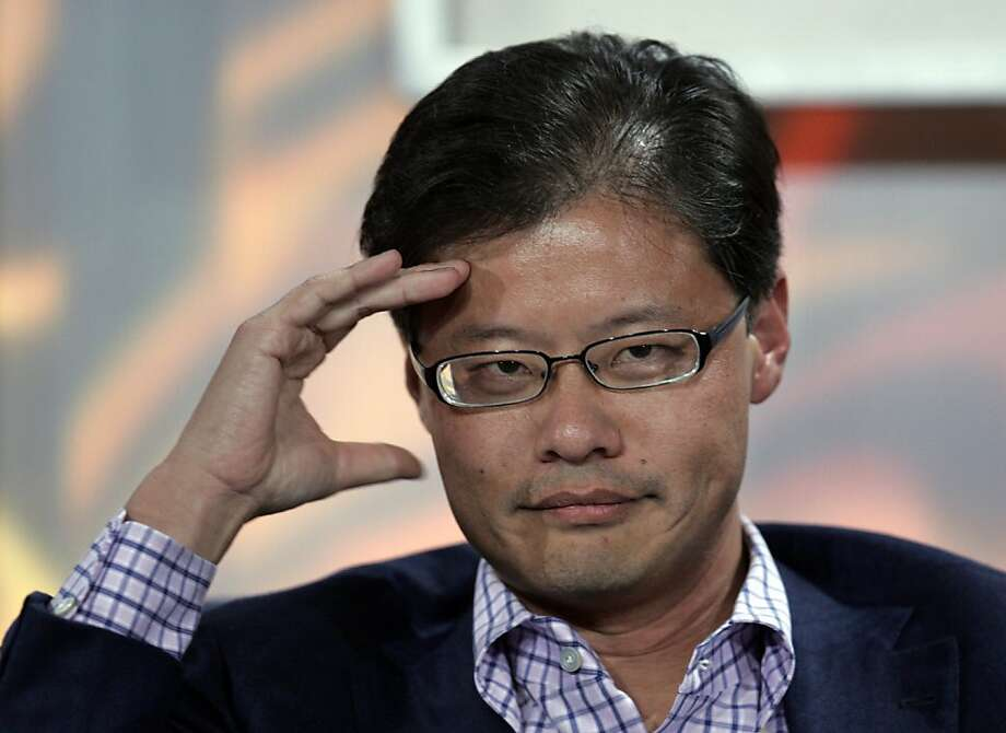 **  FILE ** In this Nov. 5, 2008 file photo, Yahoo CEO Jerry Yang listens to a question at the Web 2.0 Summit in San Francisco. Yahoo said Monday Nov. 17, 2008 that Yang will step down as the Internet company's CEO as soon as a successor is found. (AP Photo/Paul Sakuma, File) Ran on: 11-18-2008 Jerry Yang said he will resign after a successor is found. He will remain on the board. Ran on: 11-18-2008 Jerry Yang said he will resign after a successor is found. He will remain on the board. Photo: Paul Sakuma, AP