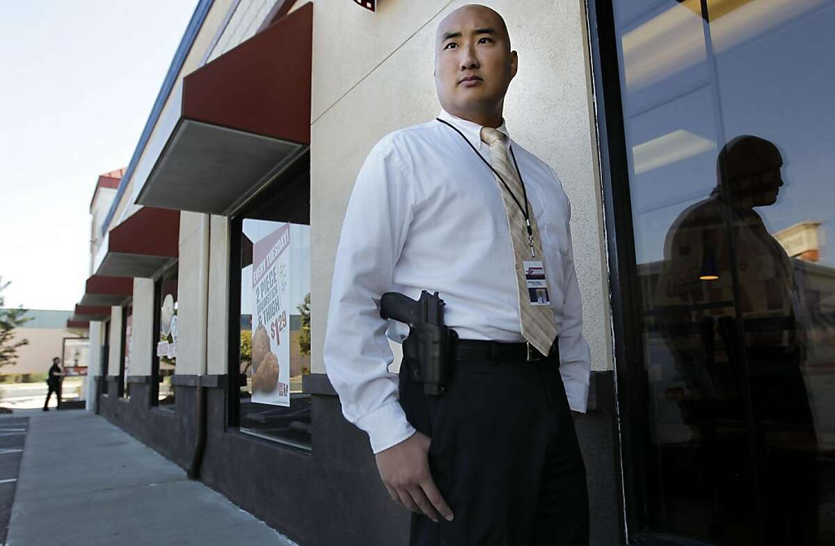 The press secretary of the gun rights group Responsible Citizens of California, Yih-Chau Chang with his Sig Sauer P226 .40 Smith and Wesson sidearm he openly and legally carries on his belt, in San Leandro, Ca., on Thursday October 20, 2011.