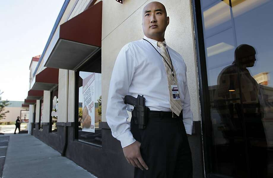 The press secretary of the gun rights group Responsible Citizens of California, Yih-Chau Chang with his Sig Sauer P226 .40 Smith and Wesson sidearm he openly and legally carries on his belt, in San Leandro, Ca., on Thursday October 20, 2011. Photo: Michael Macor, The Chronicle