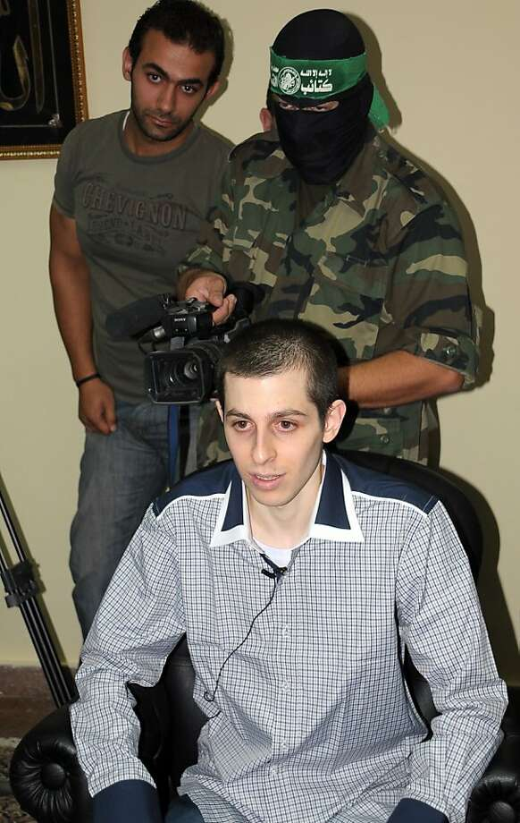 Israeli soldier Gilad Shalit speaks during an interview with Hamas TV at an undisclosed location on October 18, 2011 prior to his release after 5 years of Hamas captivity under the terms of an Egyptian-mediated deal that will see Israel release a total of 1,027 Palestinian prisoners. AFP PHOTO/STR (Photo credit should read -/AFP/Getty Images) Photo: -, AFP/Getty Images