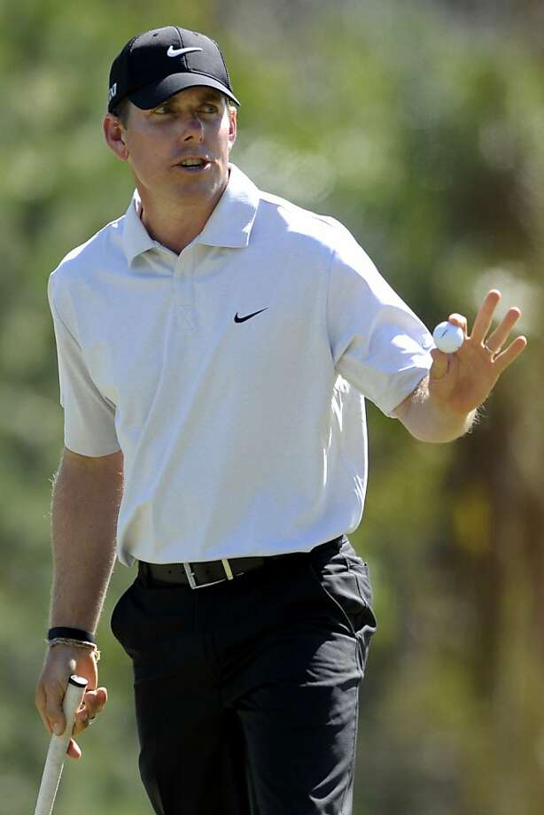 Justin Leonard acknowledges the crowd after putting for par on the 18th hole during the second round of the Children's Miracle Network Classic golf tournament in Lake Buena Vista, Fla., Friday, Oct. 21, 2011. (AP Photo/Phelan M. Ebenhack) Photo: Phelan M. Ebenhack, AP