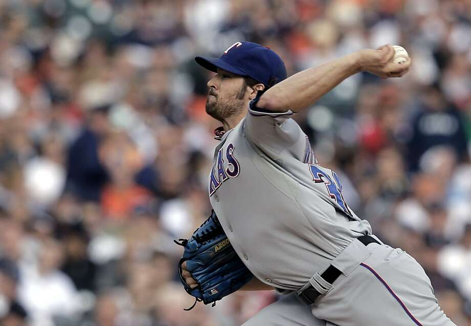 Texas Rangers starting pitcher C.J. Wilson throws during the first inning in Game 5 of baseball's American League championship series against the Detroit Tigers Thursday, Oct. 13, 2011, in Detroit. (AP Photo/Charlie Riedel) Photo: Charlie Riedel, AP