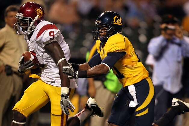 USC Trojans Marqise Lee #9 runs for a first half touchdown after catching a pass from Matt Barkley against the California Golden Bears Stepan McClure #21 at AT&T Park on October 13, 2011 in San Francisco, California. Photo: Lance Iversen, The Chronicle