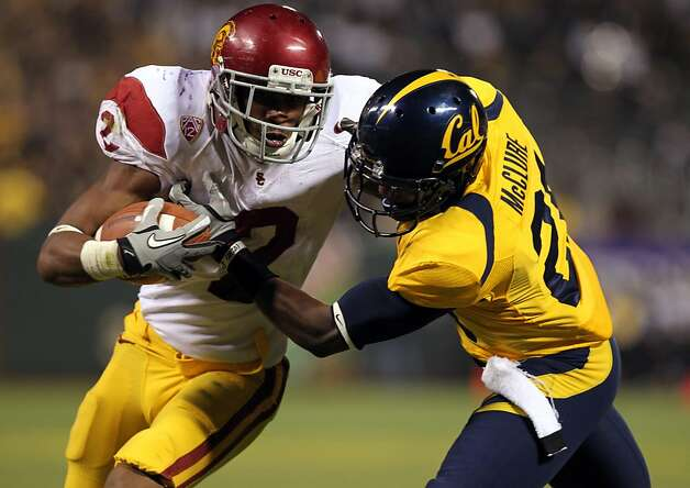 Robert Woods #2 of the USC Trojans gets a first down on a pass play in the first half of their game with the California Golden Bears at AT&T Park on October 13, 2011 in San Francisco, California. defending for Cal was Stefan McClure #21. Photo: Lance Iversen, The Chronicle