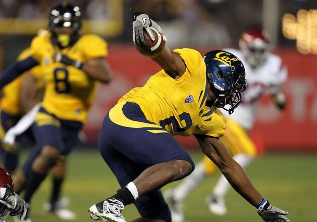 California Golden Bears Coleman Edmond keeps his balance as he scrambles for yards in the first half against the USC Trojans at AT&T Park on October 13, 2011 in San Francisco, California. Photo: Lance Iversen, The Chronicle