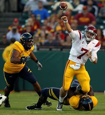 Matt Barkkley #7 of the USC Trojans iwas called for grounding the ball while being tackled by the California Golden Bears at AT&T Park on October 13, 2011 in San Francisco, California. Photo: Lance Iversen, The Chronicle