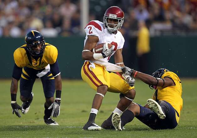 Robert Woods #2 of the USC Trojans gets a first down on a pass play in the first half of their game with the California Golden Bears at AT&T Park on October 13, 2011 in San Francisco, California.  Ran on: 10-14-2011 USC's Robert Woods caught a team-high 5 passes from Matt Barkley, who threw for just 195 yards but avoided the kind of mistakes that doomed Cal. Photo: Lance Iversen, The Chronicle