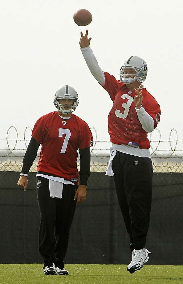 New Oakland Raiders quarterback Carson Palmer (3) throws a pass as quarterback Kyle Boller (7) looks on during NFL football practice, Wednesday, Oct. 19, 2011, in Alameda, Calif. (AP Photo/Ben Margot) Photo: Ben Margot, AP