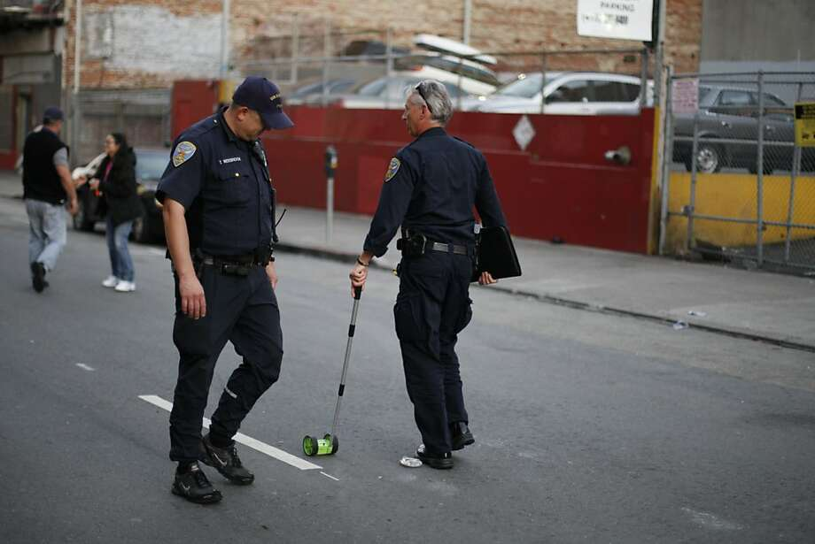 Police investigate the crime scene where two victims were shot by at least one assailant at large in a pending investigation at 96 Turk Street between Taylor and Mason Streets in San Francisco, Calif. Oct. 21, 2011. Photo: Tim Maloney, The Chronicle