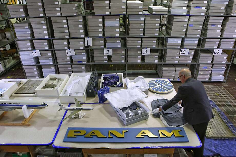 "Curator and assistant director of aviation, John Hill diplays a few Pan Am items which include the stewardess uniforms of the 1960's,  by Beverley Hills designer, Don Loper, kept at a storage facility outside the San Francisco Airport's Aviation Museum in San Francisco, Ca., on Wednesday October 12, 2011. In ABC television's new drama ""Pan Am"" set in the early 1960's, pilots and stewardesses onboard the iconic airline jet off to Paris, Rome and New York City, but research for the show took flight in San Francisco as the director, costumers and set designers traveled to the SFO Museum to dig through files to get everything from the correct cabin interiors of the aircraft to the style of uniforms for the pilots and stewardesses. Photo: Michael Macor, The Chronicle"
