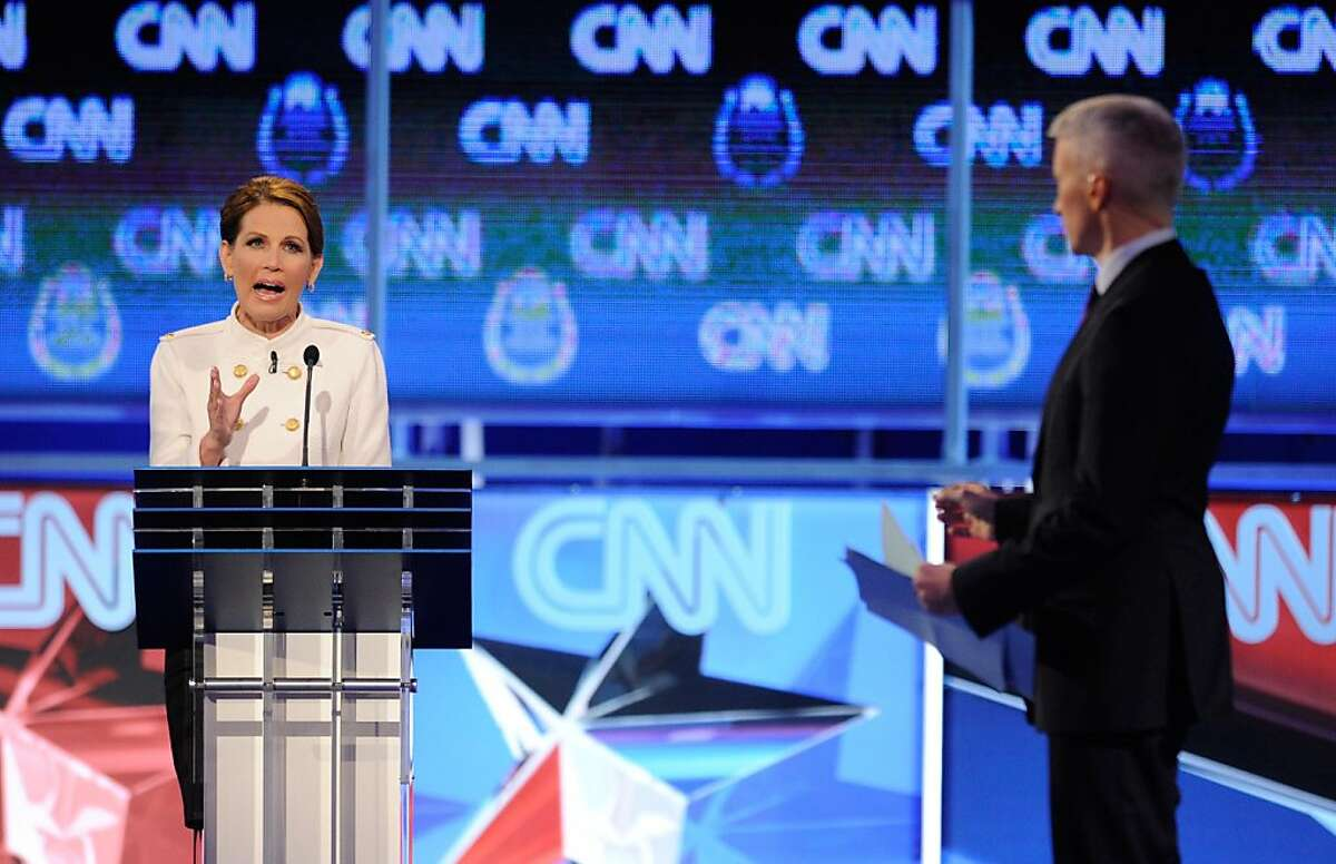 LAS VEGAS, NV - OCTOBER 18: U.S. Rep. Michele Bachmann (R-MN) (L) and CNNÌ¥s Anderson Cooper at the Republican presidential debate airing on CNN, October 18, 2011 in Las Vegas, Nevada. Seven GOP contenders are taking part in the debate, which is sponsored by the Western Republican Leadership Conference in Las Vegas and held in the Venetian Hotel's Sands Expo and Convention Center. (Photo by Ethan Miller/Getty Images)