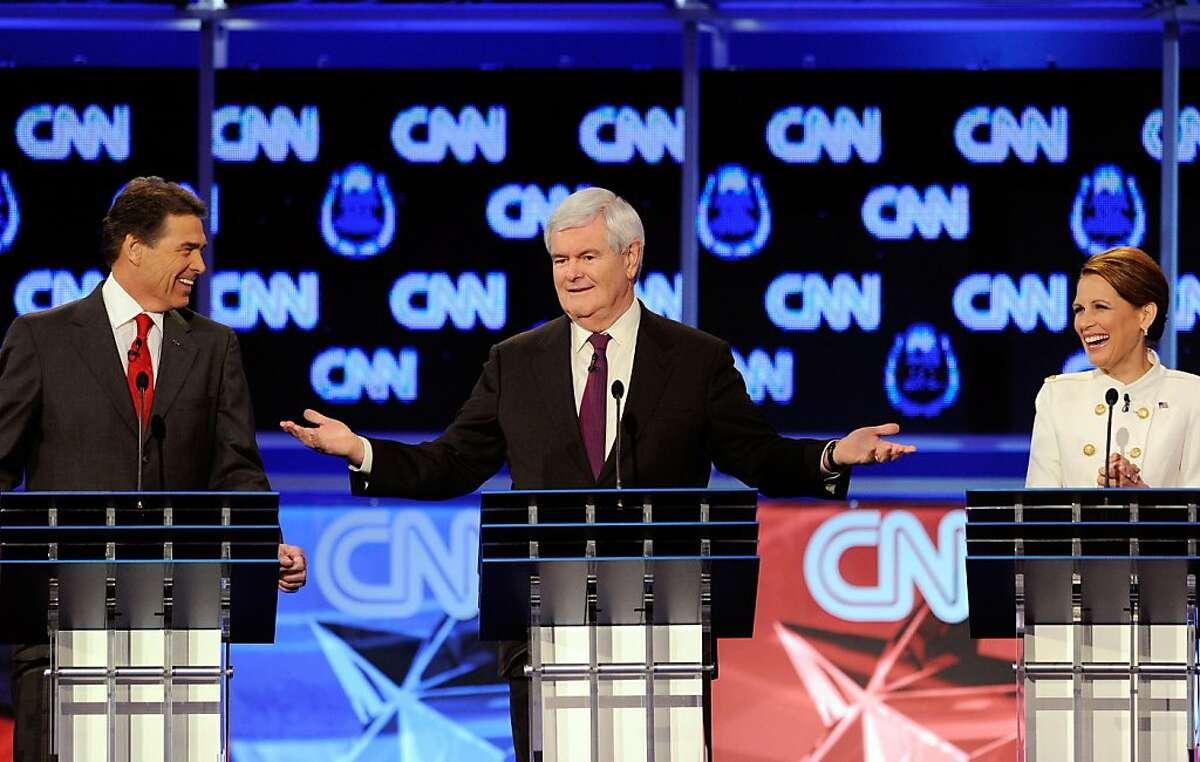 LAS VEGAS, NV - OCTOBER 18: (L-R) Texas Gov. Rick Perry, former Speaker of the House Newt Gingrich and U.S. Rep. Michele Bachmann (R-MN) participate in the Republican presidential debate airing on CNN, October 18, 2011 in Las Vegas, Nevada. Seven GOP contenders are taking part in the debate, which is sponsored by the Western Republican Leadership Conference in Las Vegas and held in the Venetian Hotel's Sands Expo and Convention Center. (Photo by Ethan Miller/Getty Images)