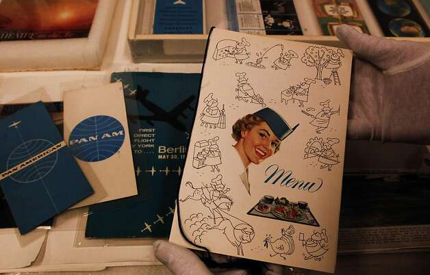 "A 1960's era in-flight dinner menu is displayed at the San Francisco Airport's Aviation Museum in San Francisco, Ca., on Wednesday October 12, 2011. In ABC television's new drama ""Pan Am"" set in the early 1960's, pilots and stewardesses onboard the iconic airline jet off to Paris, Rome and New York City, but research for the show took flight in San Francisco as the director, costumers and set designers traveled to the SFO Museum to dig through files to get everything from the correct cabin interiors of the aircraft to the style of uniforms for the pilots and stewardesses. Photo: Michael Macor, The Chronicle"