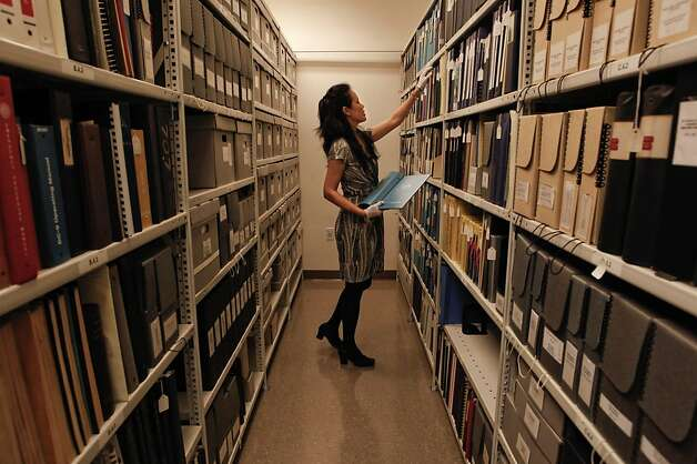 "Librarian, Julie Takata with the archives of published materials related to aviation history, stored at the San Francisco Airport's Aviation Museum in San Francisco, Ca., on Wednesday October 12, 2011. In ABC television's new drama ""Pan Am"" set in the early 1960's, pilots and stewardesses onboard the iconic airline jet off to Paris, Rome and New York City, but research for the show took flight in San Francisco as the director, costumers and set designers traveled to the SFO Museum to dig through files to get everything from the correct cabin interiors of the aircraft to the style of uniforms for the pilots and stewardesses. Photo: Michael Macor, The Chronicle"