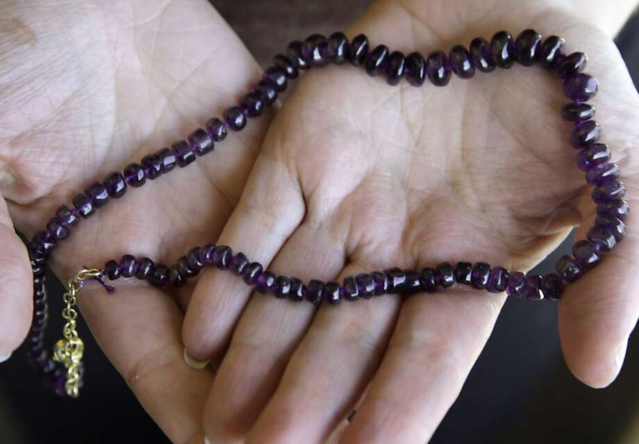 An amethyst necklace is displayed in this photograph in New York, Tuesday, Oct. 18, 2011. Online jeweler Stauer is offering a $249 amethyst necklace for free _ provided customers pay the $24.95 it costs to ship it. Stauer is losing money by giving the necklaces away, but it hopes it will reel in new customers and spur them to buy other jewelry. (AP Photo) Photo: Richard Drew, AP