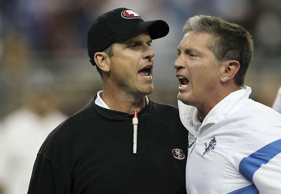 DETROIT - OCTOBER 16:  Jim Harbaugh head coach of the San Francisco 49ers argues with Jim Schwartz of the Detroit Lions during the NFL game at Ford Field on October 16, 2011 in Detroit, Michigan. The 49ers defeated the Lions 25-19.  (Photo by Leon Halip/Getty Images) Photo: Leon Halip, Getty Images