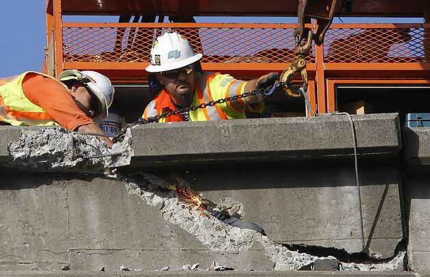 Caltrans works on structural damage to southbound 101 highway at 16th Street in San Francisco, Calif., from a tanker truck accident that happened around 5am this morning on Wednesday, October 19, 2011.  Southbound traffic on 101 from 9th to Cesar Chavez will be closed until repaired. Photo: Liz Hafalia, The Chronicle