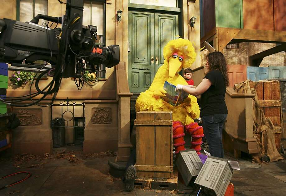 Michelle Hickey, a Muppet wrangler, helps Big Bird hold a book during a rehearsal of Sesame Street on Thursday, April 10, 2008 in New York. Being Big Bird is sweaty, physical work. But puppeteer Caroll Spinney, who has worked on Sesame Street for nearly four decades playing both Big Bird and Oscar the Grouch, has no wish to be anywhere else. (AP Photo/Mark Lennihan) Ran on: 06-21-2008 Michelle Hickey, a senior Muppet wrangler, helps Big Bird hold a book during a rehearsal of &quo;Sesame Street&quo; in New York. Photo: Mark Lennihan, AP