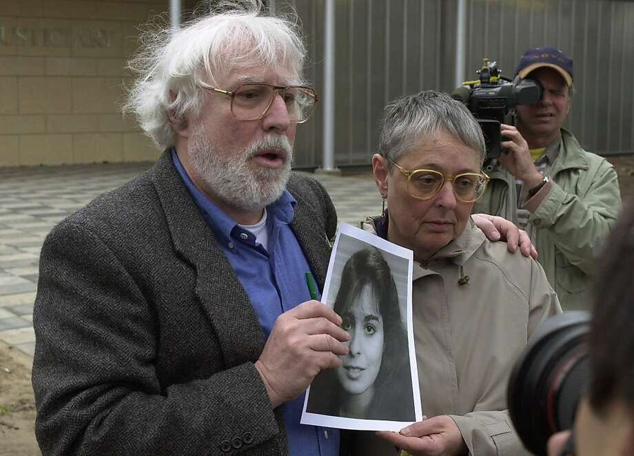 Dan and Susan Cohen of Cape May Court House, New Jersey, hold a picture of their daughter Theodora who was killed in the Lockerbie bomb attack on Pan Am Flight 103, at the entrance to the Scottish Court at Camp Zeist, The Netherlands, Wednesday, May 3, 2000. The trial against two Libyans accused of bombing the airliner over Lockerbie, Scotland opened Wednesday with the two accused pleading innocent. (AP Photo/Peter Dejong)  Ran on: 10-21-2011 Dan and Susan Cohen of New Jersey lost their daughter Theodora in the '88 PanAm bombing. Photo: Peter Dejong, Associated Press